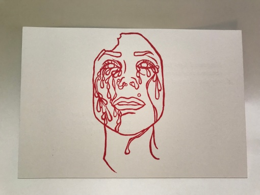 Crying Face with Nose Rings Postcard Front